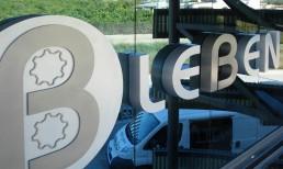 Logotipo y letras corpóreas combinadas de aluminio y acero inoxidable sin luz by Aplikados